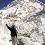Hiker stands in the Khumbu Icefield at the basecamp of Mt Everest, Nepal.